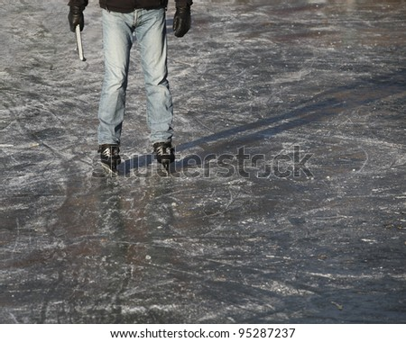 Dutch ice skater standing on ice - stock photo