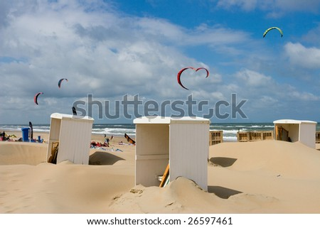 Dutch landscape with sea and beach with cab for dressing and kite surfing - stock photo