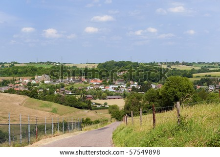 Dutch landscape with small village in province Limburg - stock photo