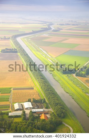 Dutch landscape with straight canal from above  - stock photo