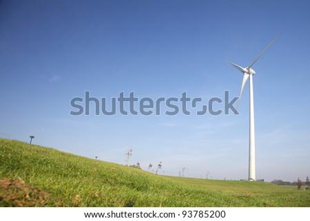 Dutch landscape with Windturbine - stock photo