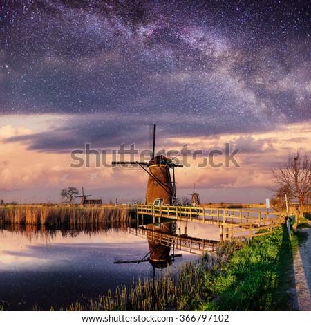 Dutch mill at night. Starry sky. Holland. Netherlands. - stock photo