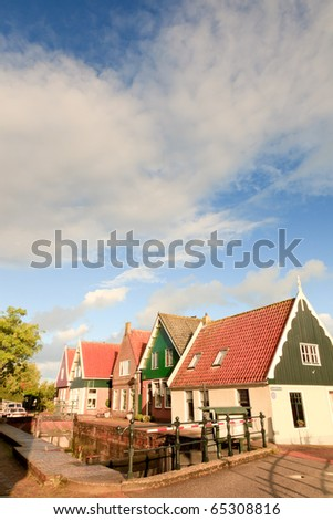 Dutch old village with small houses under blue cloudy sky