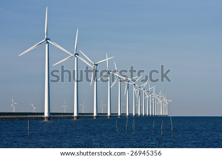Dutch Power, wind-turbines in the sea - stock photo