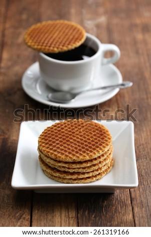 dutch stroopwafel, caramel waffle and coffee - stock photo