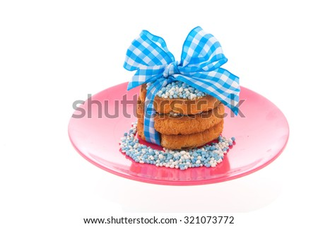 Dutch tradition with pink mice on biscuit while baby born isolated over white background - stock photo
