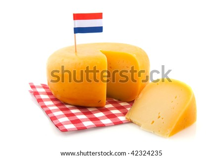 Dutch whole cheese with flag and checkered napkin - stock photo