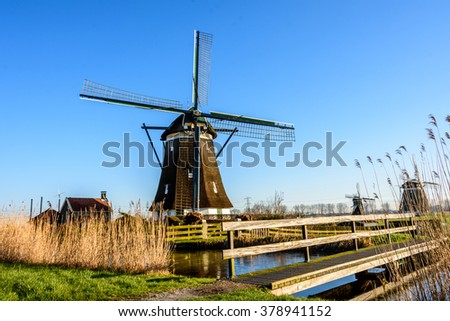 Dutch windmill and miniature windmill near Zevenhuizen in the province of South Holland, Netherlands - stock photo