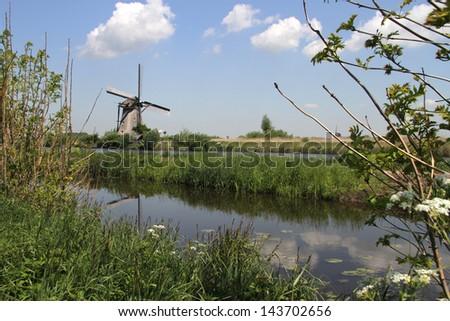 Dutch windmills near Kinderdijk, The Netherlands - stock photo