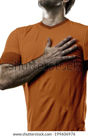 Dutchman soccer player, listening to the national anthem with his hand on his chest. On a white background. - stock photo
