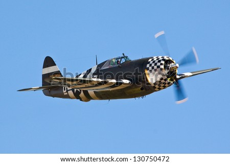 "DUXFORD, CAMBRIDGESHIRE, UK - SEPTEMBER 8: Republic P-47G Thunderbolt ""SNAFU"" flying on September 8, 2012 at the Duxford Air Show event in Duxford, Cambridgeshire, UK. - stock photo"