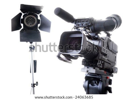 dv-cam camcorder and light in studio - stock photo