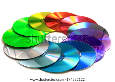DVD and CD data disc in the rainbow colors isolated on the white background  - stock photo