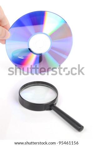 DVD and magnifier - stock photo
