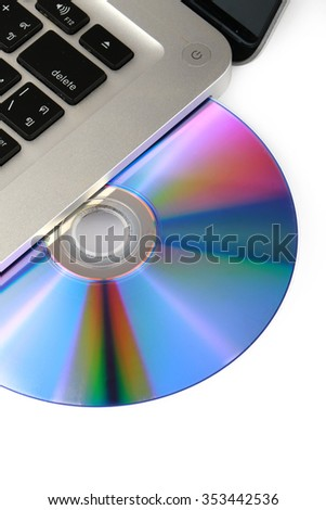 DVD, CD disk in the drive of a laptop white background, close-up, isolated - stock photo