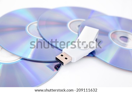 DVD disc and USB flash drive on white background - stock photo
