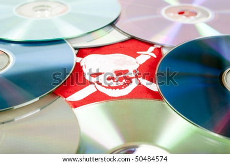 Dvd disks with pirate skull, concept - stock photo