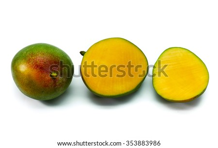Dwarf yellow mango fruits, sliced and isolated on white