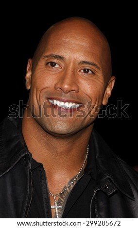 """Dwayne Johnson at the Los Angeles premiere of 'Faster"""" held at the Grauman's Chinese Theater in Hollywood on November 22, 2010.   - stock photo"""