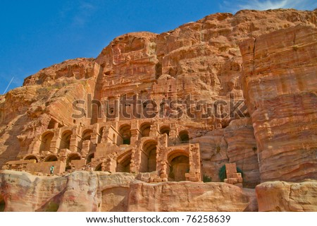 Dwellings carved into the stone cliffs of ancient Petra, Jordan - stock photo