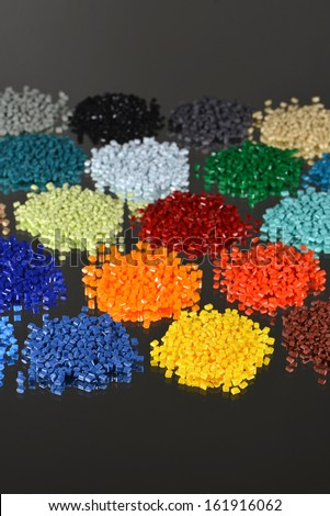 dyed polymer resin in lab for injection moulding process - stock photo