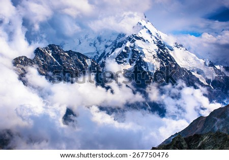 Dykh-Tau, 5,204 m - the second highest mountain in Russia, after Mount Elbrus. Caucasus, Bezengi region, Kabardino-Balkaria - stock photo