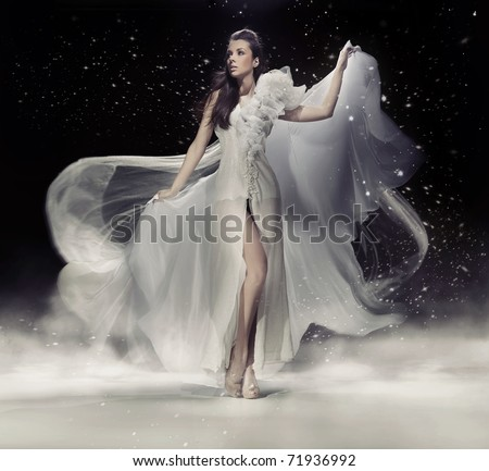 Dynamic image of a beautiful woman shot in studio - stock photo