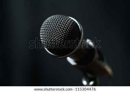 Dynamic microphone close-up on dark background - stock photo