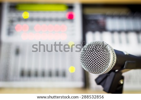 dynamic microphone & digital studio mixer + colorful bokeh light on background for music recording, radio / tv broadcasting  background - stock photo