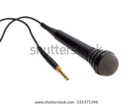 Dynamic microphone in black plastic housing with a cable, yellow phone connector and windscreen in wire mesh on a light background  - stock photo
