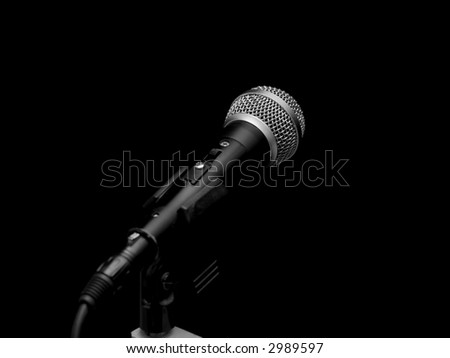 Dynamic microphone on stand isolated on black - stock photo