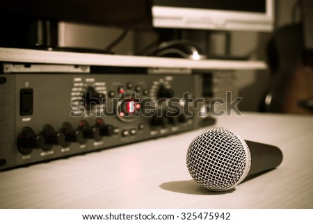 dynamic microphone & recording studio gears, acoustic guitar on background + art color filter for studio music recording concept - stock photo