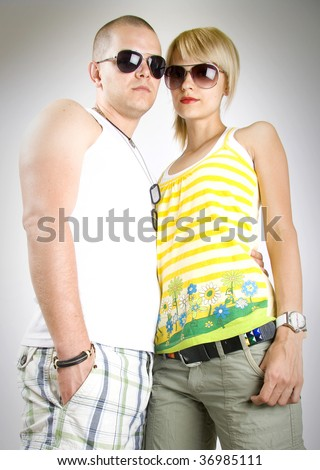 dynamic picture of a casual young couple wearing sunglasses