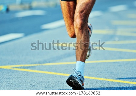 Dynamic run of marathoner on a finish line - stock photo