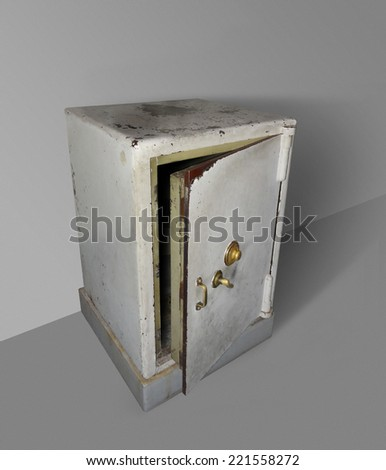 dynamic shot of a old rundown open safe in sparse ambiance - stock photo