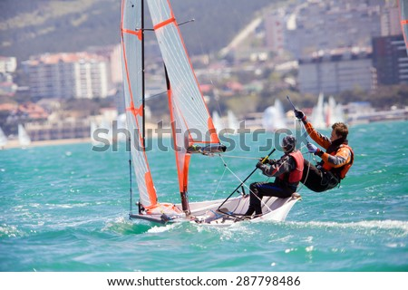 dynamic team struggle to the regatta sailing ship - stock photo