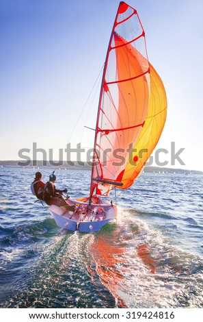 dynamic team struggle to the regatta sailing ship - stock photo