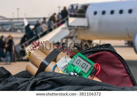 Dynamite bomb in bag in airport. Terrorism concept. - stock photo