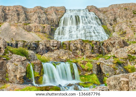 Dynjandi is the most famous waterfall of the West Fjords and one of the most beautiful waterfalls in the whole Iceland. - stock photo
