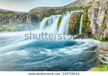 Dynjandi is the most famous waterfall of the West Fjords and one of the most beautiful waterfalls in the whole Iceland. It is actually the cascade of waterfalls - stock photo