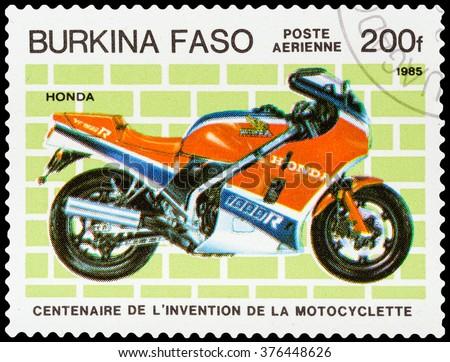 DZERZHINSK, RUSSIA - FEBRUARY 04, 2016: A postage stamp of BURKINA FASO shows vintage motorcycle, Honda, circa 1985 - stock photo