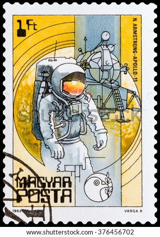DZERZHINSK, RUSSIA - FEBRUARY 04, 2016: A postage stamp of HUNGARY shows Neil Armstrong's first steps on the moon, circa 1986 - stock photo