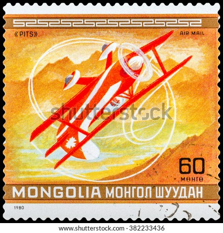 DZERZHINSK, RUSSIA - FEBRUARY 11, 2016: A postage stamp of MONGOLIA shows aircraft Pits, Canada, circa 1980 - stock photo