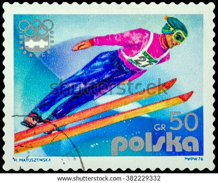 DZERZHINSK, RUSSIA - FEBRUARY 11, 2016: A postage stamp of POLAND shows Ski jumping and Emblem, 12th Winter Games, Innsbruck, Austria, circa 1976 - stock photo