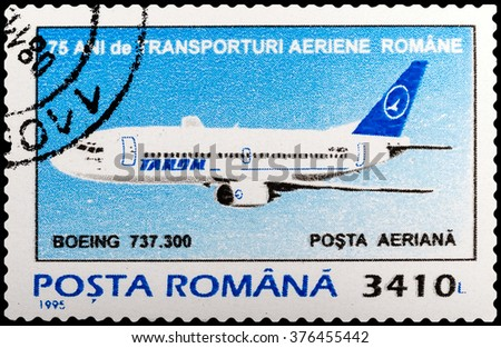 DZERZHINSK, RUSSIA - FEBRUARY 04, 2016: A postage stamp of ROMANIA shows Boeing 737-300, circa 1995 - stock photo