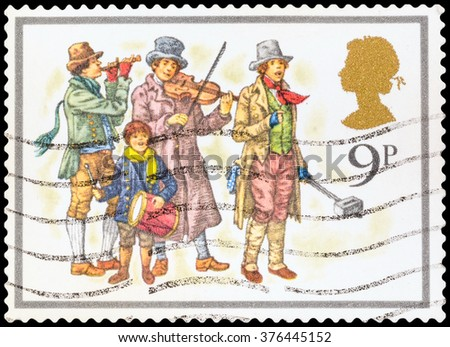 DZERZHINSK, RUSSIA - FEBRUARY 04, 2016: A postage stamp of UNITED KINGDOM shows musicians, devoted Christmas, circa 1977 - stock photo