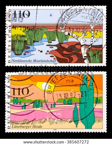 DZERZHINSK, RUSSIA - FEBRUARY 04, 2016: Set of a postage stamp of GERMANY shows Moorland, Scenic Region and Luneburg Heath, circa 1997 - stock photo