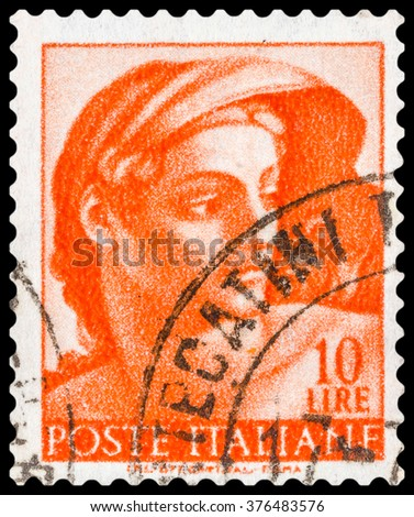 """DZERZHINSK, RUSSIA - JANUARY 18, 2016: A postage stamp of ITALY shows head of the """"Ignudi"""" from Sistine Chapel, circa 1961 - stock photo"""