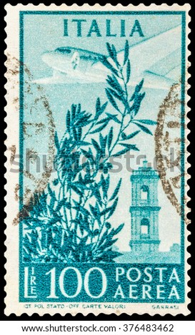 DZERZHINSK, RUSSIA - JANUARY 18, 2016: A postage stamp of ITALY shows Plane over Capitol Bell Tower, circa 1954 - stock photo