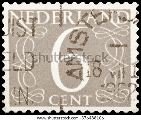 DZERZHINSK, RUSSIA - JANUARY 18, 2016: A postage stamp of NETHERLANDS shows numeric value 6 cent, circa 1955 - stock photo